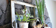 a spring fireplace mantel that never wilts, fireplaces mantels, flowers, home decor, Pretty greens although faux ring in spring perfectly on this fireplace mantel The decor is very simple but sometimes that s all you really need