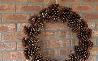 too many pine cones in your yard make a diy pinecone wreath, crafts, seasonal holiday decor, wreaths, This is what the finished product looks like Ribbons are not my area of expertise but the better you are with ribbons I think the better the finished product will look