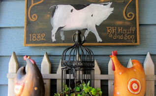 covered patio outdoor vignettes, home decor, outdoor living, repurposing upcycling, I displayed the bird cage with roosters and a pig sign
