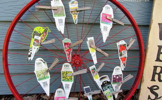 bike wheel plant label tag organizer, flowers, gardening, repurposing upcycling, I used an old bike wheel that had been spray painted red The same wheel I used on my Christmas mantel on Hometalk