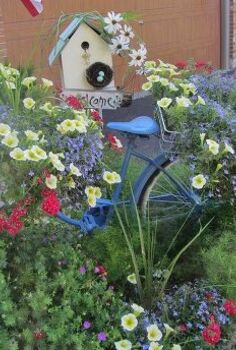 vintage summer garden, flowers, gardening, outdoor living, repurposing upcycling, This is my old vintage bike I painted blue and then added sun loving flowers to the vintage baskets on the bike This is an easy and sweet way to use something vintage for a focal point in the garden