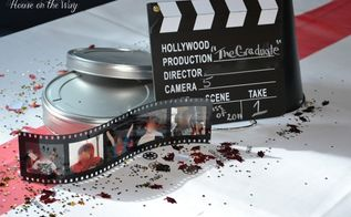 graduation party idea a movie themed graduation party, crafts, The centerpieces consisted of silver metal movie reel cases clapboards filmstrip photo frames and director megaphones Graduation and movie confetti were sprinkled on the tables