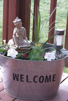 metal galvanized tub turned mini flower garden, flowers, gardening, repurposing upcycling, When it lights up at night with the solar light it is very pretty