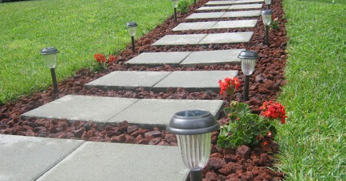 Front walkway built out of inexpensive cement pavers red for Small red rocks for landscaping