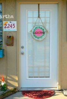 back porch, flowers, foyer, wreaths, Finding inexpensive ways to add life to a dull back entrance Spray a cheap rubber mat with a fun color A cheap dollar tray is painted and used for a welcome wreath A rubber mat filled with pea gravel is a drain mat