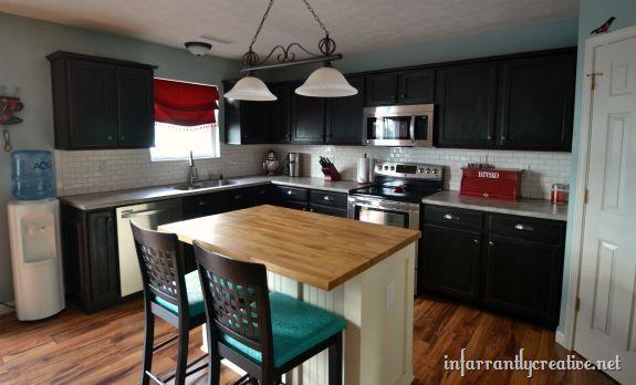 White Subway Tile Backsplash With Black Cabinets Kitchen Backsplash Kitchen Design Tiling