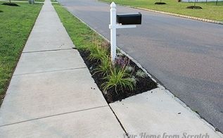 protecting mulch beds with a stone perimeter, concrete masonry, diy, flowers, gardening, This is what we started with We had just made a new flower bed around our mailbox and mulched it During torrential rain the water washes the mulch along the edge