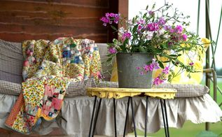 rustic log home porch decor using sweet pea wildflowers, decks, home decor, porches, Porch swing of a log home