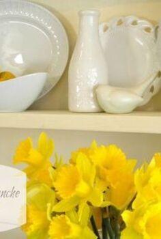 fresh look for my hutch, painted furniture, Several shades of white dishes and a few pops of yellow for Easter are sitting pretty on my hutch and making my dining room a much brighter and happier space