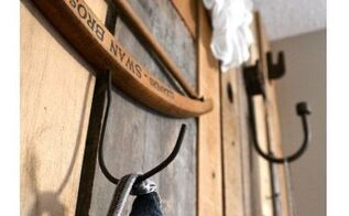 fall in love hanging up your clothes with a pallet wood closet wall, cleaning tips, hardwood floors, woodworking projects, What are these wacky random hooks doing