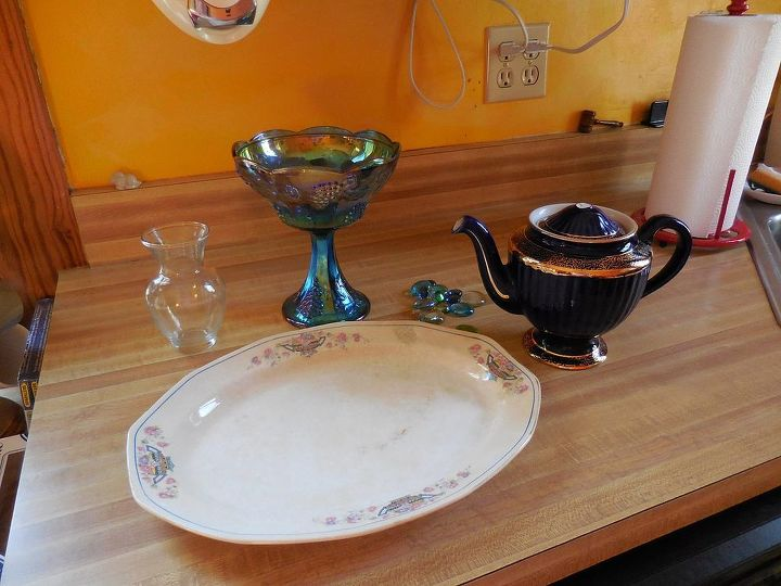 Garden art from vintage teapot and dishes hometalk for Garden art from old dishes