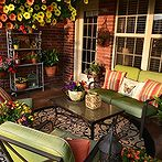 11 stunning patio ideas for under 100, decks, home decor, outdoor living, repurposing upcycling, Cheery Colorful Patio via Kristen s Creations