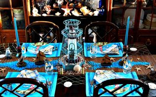 nautical tablescape with lighthouses, home decor, Sailboats and lighthouse candle holders