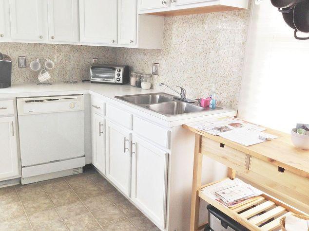 Grey quartz countertop with white cabinets