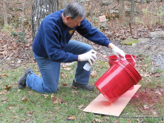 Turn 5 gallon buckets into christmas porch decor hometalk for How to decorate a bucket