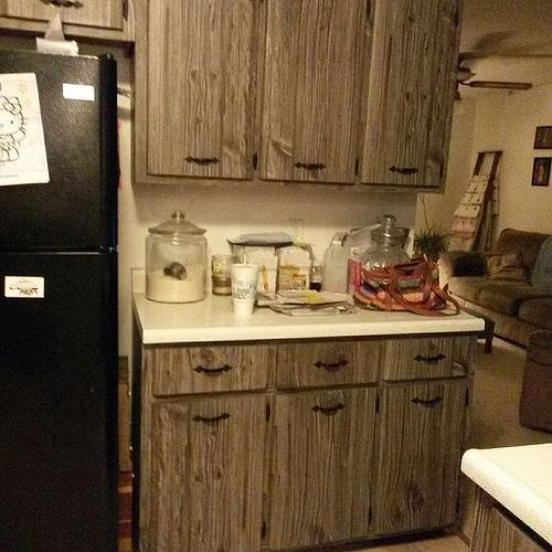 what would you do with these fake barn wood cabinets grace lee cottage updating old kitchen cabinets
