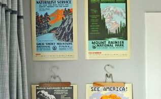 vintage travel posters hung with antique hangers, repurposing upcycling, wall decor