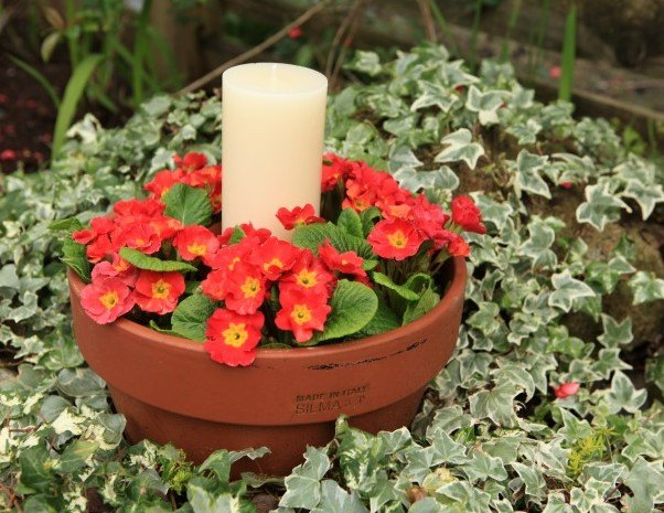 Diy outdoor table centerpiece with flowers and candles