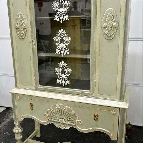 I bought mine for $25 at a church rummage sale. I used Annie Sloan chalk paints, added wooden appliques to side panels and top for interest and stenciled inside the glass door. I'm using it in my studio to organize art supplies.