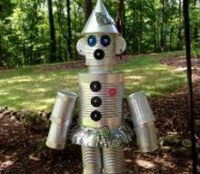 repurposed tin cans to the wizard of oz s tin man his girlfriend the tin lady, crafts, gardening, how to, outdoor living, repurposing upcycling