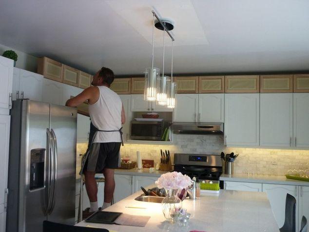Kitchen transformation hometalk for Add glass to kitchen cabinets