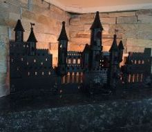 princess castle becomes harry potter hogwarts for halloween, halloween decorations, repurposing upcycling, seasonal holiday decor