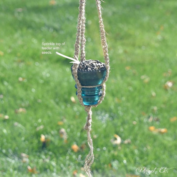 Simple vintage glass insulator bird feeder for fall for Glass insulators crafts