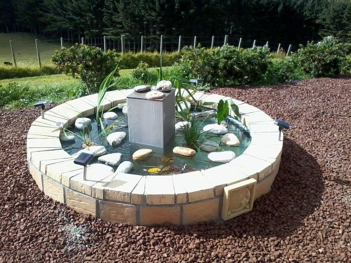 Upcycling an old spa into a fishpond fountain hometalk for Garden spas pool germantown tn