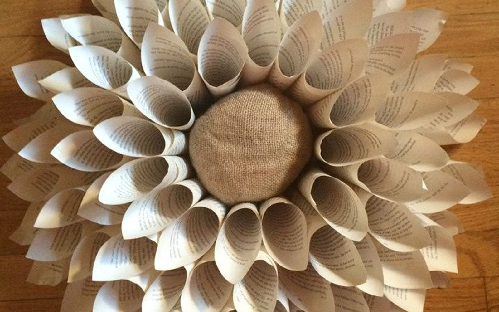 s 15 brilliant ways to reuse your empty cardboard boxes, home decor, repurposing upcycling, Use It to Start a Book Page Wreath
