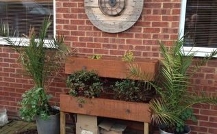 giant draw plant shelves and drum cable clock, container gardening, gardening, outdoor furniture, repurposing upcycling, shelving ideas
