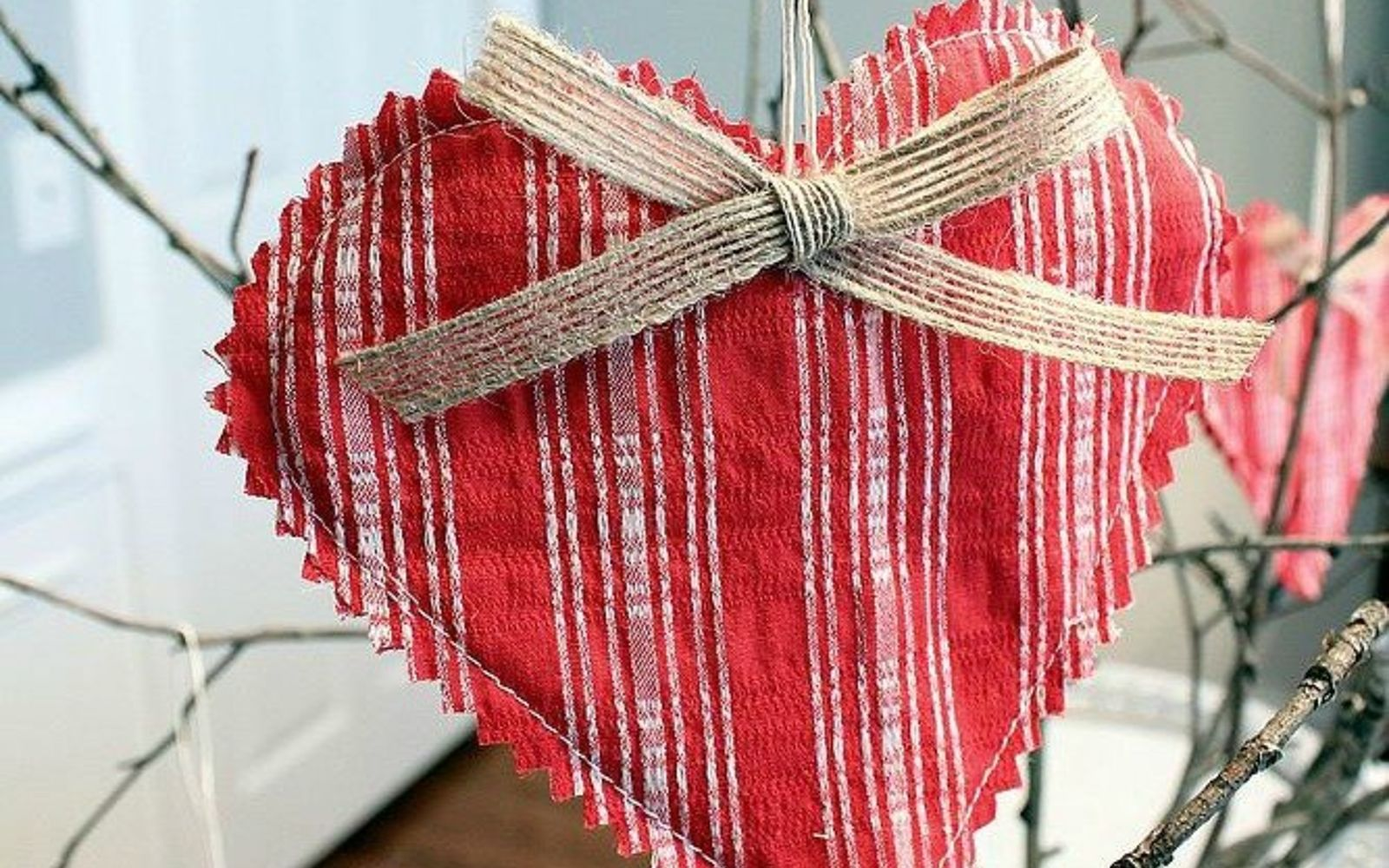 s 13 stunning vintage fabric ideas that ll send you to the thrift store, crafts, repurposing upcycling, reupholster, Scraps to Hanging Hearts