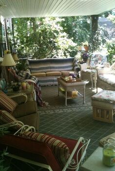 my indoor outdoor space, decks, outdoor furniture, outdoor living, Furnished with vintage stuff mom s iron set the couch we bought in yes the early 1960 s and of course a newer wicker set Love having the outdoors in