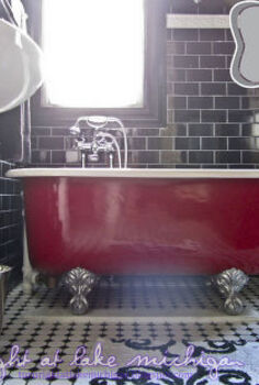 our black white amp classic master bathroom, bathroom ideas, diy, home decor, home improvement, how to, The view from the toilet ha of our tub Clementine We completely refinished her ourselves from repainting the outside red as she was when we bought her to the claw feet and the white interior