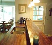 kitchen makeover with butcherblock countertops, countertops, diy, how to, kitchen backsplash, kitchen cabinets, kitchen design, This is the sink and bar area