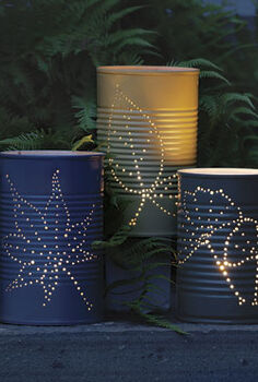 great ideas for garden lighting, crafts, lighting, outdoor living, repurposing upcycling, Turn tin cans into hanging lanterns an idea from Fine Gardening magazine via Garden Therapy