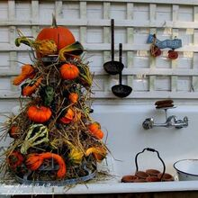 tower of gourds, seasonal holiday d cor, Our outside potting sink is decked out for Fall with a Gourd Tower made with gourds and pumpkins stuck on a wire bottle rack and filled in with hay