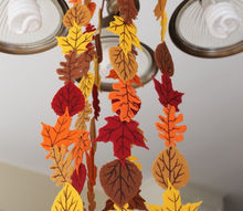 fall felt leaf garland, crafts, seasonal holiday decor, My garland hanging from the light in my kitchen