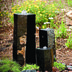 landscaping ideas fountains bubbling urns brass spitters bubbling boulders bjl, ponds water features, Bubbling Basalt Columns