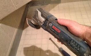 the best grout removal tools for shower tile floors, home maintenance repairs, tools, The Bosch multi tool and triangular grout removal tool in this photo removed all the shower grout