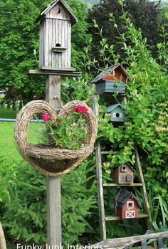 how to grow your garden with junk, flowers, gardening, outdoor living, repurposing upcycling, I call the ladder filled birdhouses the Birdie Hotel Sadly the bees generally book the pent house
