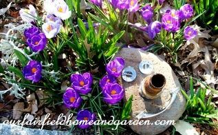 repurposing in the garden, gardening, repurposing upcycling, rock and junk drawer items turned into a garden accent