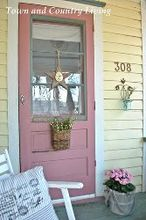 how to create front door charm, curb appeal, doors, Simple decorations like a wooden star and rustic basket flank a farmhouse door