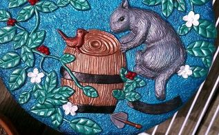 garden stepping stones, crafts, flowers, gardening, outdoor living, painting, This is the after pic of the squirrel bird the barrel I like the transformation