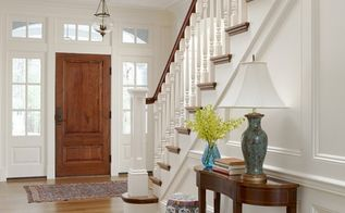 details details how you can add character and pizazz to your home, home decor, The paneling throughout this entryway is so clean and crisp painted white Love the stained wood door and railings Nice pop of color