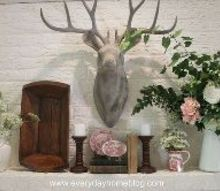 how to create a summertime mantel for free, flowers, home decor, Buck looks over a mantel filled with lacy white blossoms white farmhouse pitchers and pink and white Stafforshire dishes