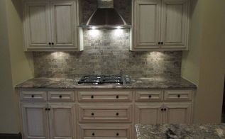 wow what a change for this kitchen, home decor, home improvement, kitchen backsplash, kitchen design, kitchen island, We choose to take the tile above and around the tops of the cabinets Added a stainless hood and DCS 30 gas stove