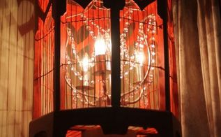 how to turn a birdcage into a chandelier, lighting, repurposing upcycling, New chandelier illuminated at night The perfect creative lighting for any space A little work turned this into a great piece