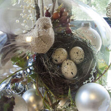 creating a woodland christmas under glass, christmas decorations, home decor, lighting, seasonal holiday decor, I loved this burlap bird By perching he and his nest on a gathering of woodland treasures that I found on a walk it was just the right balance of naturals