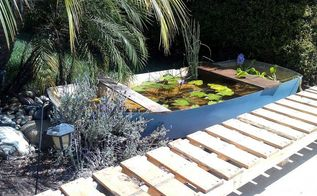 my shipwreck water lily pond, diy, flowers, gardening, outdoor living, pallet, repurposing upcycling, I created boat seats simply by laying boards across the front and back of the boat