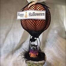 flying pumpkins, halloween decorations, seasonal holiday d cor, a foam pumpkin and fishnet stockings make a fun balloon